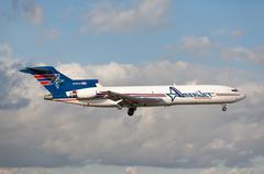 Classic Boeing 727 cargo by Amerijet landing at Miami International Airport. Stock Photos