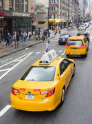 Street scene with people and yellow cab taxis in New York Kuvituskuvat