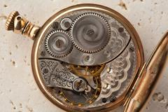 Gears and mainspring in the mechanism of a pocket watch - stock photo