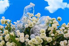 Concept of plastic bottles discarded in a park - stock photo