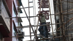 Chinese worker on scaffolding, Macau Stock Footage