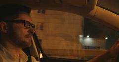 Shot of man driving at night - stock footage