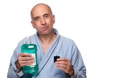 Man rinsing with mouthwash - stock photo