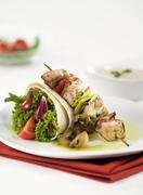 Shish kebab and filled tortilla - stock photo