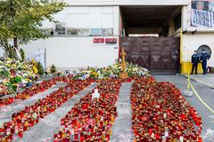 Stock Photo of Candles Lit In Memory Of The 32 Dead People In Club Disaster In Bucharest
