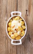 Potatoes and sour cream in a casserole dish - stock photo