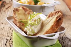 Baked potatoes with sour cream - stock photo
