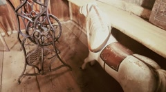 Old toy horse and sewing machine Stock Footage