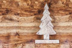 Christmas tree on wooden background Stock Photos