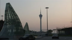 Traffic in front of Macau Tower, China Stock Footage