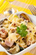 Pork and potato casserole topped with cheese Stock Photos