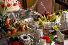 Still life of antique tableware and food - stock photo