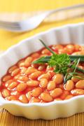 Baked beans in a porcelain casserole dish - stock photo