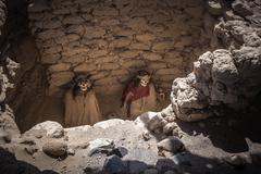 Chauchilla Cemetery with prehispanic mummies in Nazca desert, Peru - stock photo