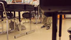 Custodian Sweeps Between The Desks Stock Footage