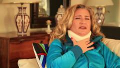Painful woman with neck brace Stock Footage
