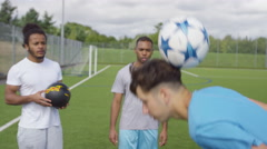 4K Talented young soccer players showing off their ball skills on soccer pitch - stock footage