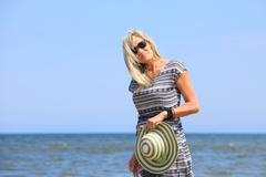 Mature woman on beach summer holiday Stock Photos