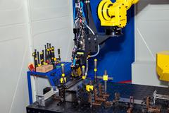 Industrial robot, close up of metal processing Stock Photos