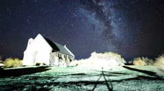 Stock Video Footage of Beautiful Milky Way Rising Over Good Shepherd Church, Timelapse Zoom In