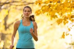 Female fitness model training outside and running Stock Photos
