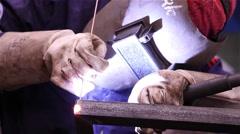 Man welding iron - stock footage