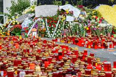 Stock Photo of People Bring Tribute In Memory Of The Colectiv Club Fire