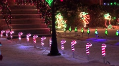 4K Christmas holiday lighted candy cane, snowy walkway Stock Footage