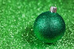 Christmas decorative green ball on glitter bokeh background - stock photo