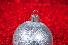 Christmas decorative ball on glitter bokeh background - stock photo
