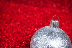 Christmas decorative ball on glitter bokeh background - stock photo