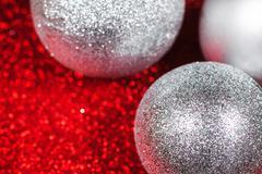 Christmas decorative balls on glitter shiny bokeh background - stock photo