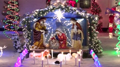 Stock Video Footage of 4K Christmas nativity outdoor lighted display, snowfall