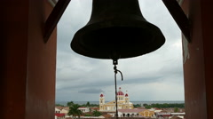 Silhouette of Church bell with Cathedral Granada in background Stock Footage