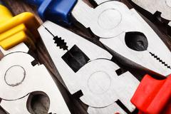 head of Pliers background - stock photo