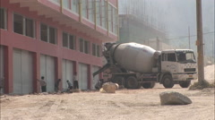 Cement truck, construction workers, China Stock Footage