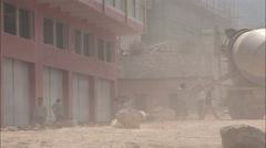 Chinese workers shovelling, dust, China Stock Footage