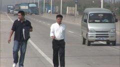 Chinese men walking on high way, China Stock Footage