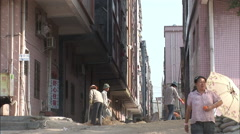 Shovelling dirt, construction workers, China Stock Footage