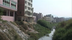 Water pollution, city river, China - stock footage