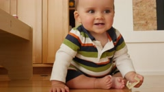 An adorable little baby boy playing with train table Stock Footage