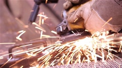 Man doing metalworking using a grinding wheel Stock Footage