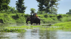 Elephant and Tourists Crossing Nepali River Stock Footage