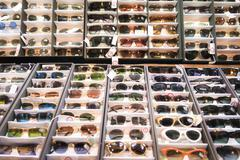 Stall exhibits many colorful vintage sunglasses. Stock Photos