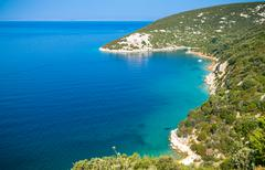 The pristine coastline and crystal clear water of the island of Rab. - stock photo