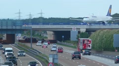 Stock Video Footage of Airplane over autobahn
