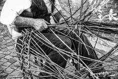 Artisan builds wicker baskets. Stock Photos