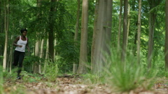 4K Fit African American woman going for a run in the woods.  Stock Footage