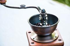 Stock Photo of Old wooden coffee grinder with handle