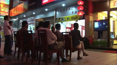 Watching television on the street, China Stock Footage